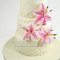 Pearl And Lily Cake Wedding cake with pearls and sugar star gazer lilies.