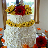 Rustic Fall Wedding Cake Rustic, messy style buttercream wedding cake with fall flowers.