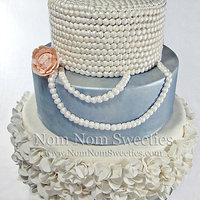 Ruffle And Pearl Cake Wedding cake with ruffles and pearls