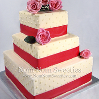 Swiss Dot Wedding Cake Swiss Dot Wedding Cake with a few sugar roses. Brides request.