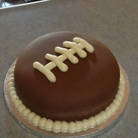 Fondant Football Cake I got bored and had an extra layer left over from the cake I did yesterday, so I made a fondant layer football cake. Because that's...