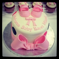 Welcome Baby Kaori Milani 3 layer red velvet cake filled and iced with buttercream covered with fondant. Bow, polka dots, shoes and letters are all made of fondant....