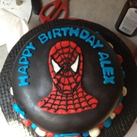 Spiderman Birthday Cake 2 layer red velvet cake with vanilla buttercream frosting tinted blue, covered in black fondant. Spiderman face is made of fondant w/ royal...