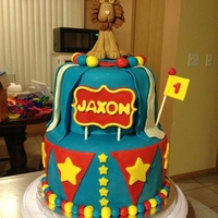 Circus Themed Birthday Cake 2 tiered circus themed birthday cake! Bottom tier is funfetti(made from scratch) and top is chocolate. Covered in fondant with fondant...