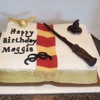 Harry Potter Book Of Spells  1/2 sheet cake. Sides are airbrushed gold, wand and hat are modeling chocolate, snitch is fondant airbrushed gold, scarf and glasses are...