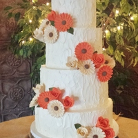 Country Chic This was my first wedding cake. The wedding was country chic themed. I made the sugar flowers (1st time too) to match her bouquet. My...
