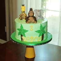 Jungle Animals 9 inch dark chocolate cake with SMBC icing. Animals are fondant.
