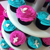 Fuchsia And Turquoise   Fuchsia and tursquoise wedding cupcakes. Rose shaped frosting with white gumpaste doves.