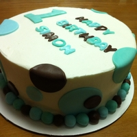 Polka Dot Cake   First birthday cake with clustered and overlapped circles in brown, sky blue, and Tiffany blue