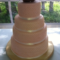 Vintage Inspired Peach Wedding Cake   Peach coloured fondant with ivory sugar pearls.