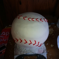 "Baseball Cake A nearly 12"" diametre baseball cake for my son's birthday/baseball team. Please excuse the mess."