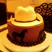 Cowboy Hat Cake For my father in law B Day, The hat is One 6 inch cake torted and filled with buttercream, top is carved to look like cowboy hat. The brim...