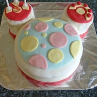 "Mickey Mouse Clubhouse ""toodles"" Cake  This was the first fondant cake I have ever made. It was for my daughter's 3rd birthday, and she loved Mickey Mouse Clubhouse. I made..."