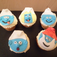 The Smurfs Cupcakes With Buttercream And Madera Cupcake The Smurfs cupcakes, with buttercream and madera cupcake.