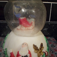 Christmas Snow Globe A Christmas snow globe made with gelatine, this is a chocolate caramel biscuit cake with fondant molded and painted, Merry Christmas!