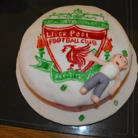 Liverpool  a hand painted Liverpool crest with a drunken man and a few bear cans scattered around the cake, it was a sponge cake with a chocolate...
