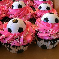 Soccer Cupcakes For My Younger Daughters Team Soccer Ball Is A Plastic Ring Pink Was Their Team Color Soccer Cupcakes for my younger daughter's team. Soccer ball is a plastic ring. Pink was their team color.