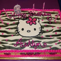Hello Kitty Half sheet vanilla cake. Air brushed zebra stripes with FBCT Hello Kitty. Matching 6 candle.
