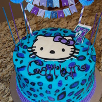 "Hello Kitty Cheetah Hello Kitty and Cheetah themed birthday cake. 8"" Marble cake with chocolate whipped cream filling. Buttercream frosting with a FBCT..."