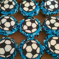 Soccer Cupcakes For My Older Daughters Team Soccer Ball Is Made Out Of Candy Melts Blue Was Their Team Color Soccer Cupcakes for my older daughter's team. Soccer ball is made out of candy melts. Blue was their team color.