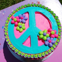 Peace Sign Cake Marble Cake with Cookies and Cream Whip Cream filling. Vanilla Buttercream Frosting. Made this for my 5 yr old daughter for her birthday....