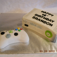 Xbox Console And Controller Cake The console is yellow cake covered with buttercream frosting and fondant detailing and silver dragees. The controller is made of rice...
