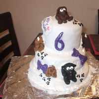 "1330970669.jpg  My daughters 6th birthday cake. She wanted ""puppies getting into it."" Everything is COMPLETELY edible.... not even cake boards in..."