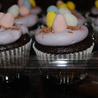 Easter Egg Cupcakes These were chocolate cupcakes with purple buttercream, a chocolate nest and chocolate eggs:)