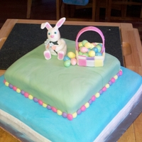 My Easter Bunny Cake This is a yellow cake with vanilla buttercream frosting and covered in vanilla fondant. The Easter Bunny and basket are made from fondant....