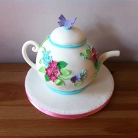 Vintage Teapot Orange sponge with orange blossom buttercream.Got this design from CakeCentral and loved it so much that i decided to give it a go!
