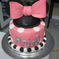 "Minnie Mouse Cake 6"" double layer, vanilla/chocolate marble cake with vanilla frosting. This served as the top tier to Mickey and Minnie Mouse cupcakes..."
