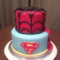 Spiderman Superman Superhero Cake Cute stacked cake with spiderman on top and superman - complete with cape - on the bottom