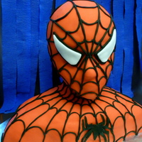 Spiderman Spiderman cake! Head is a styrofoam mannequin covered with fondant. Body is sculpted yellow cake.
