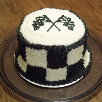 "Checkered Flag Cake   6"" Round Dark chocolate cake with BC, image is BC transfer technique."