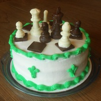 Chess Cake Chocolate and vanilla checkered cake with butter cream frosting and white and dark chocolate decorations.