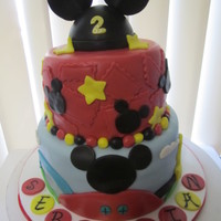 Mickey Mouse Mickey Mouse Clubhouse cake. Covered in MMF. Mickey head topper is cake, ears are gumpaste.