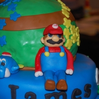Super Mario Cake The earth is made out of rice crispy treats. Super Mario is made out of fondant and gumpaste.