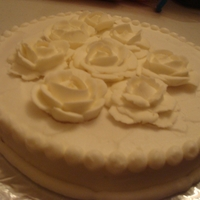 All White Rose Cake   Roses made with royal icing. Dot and straight line border with buttercream icing.