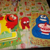 Elmo, Cookie Monster Elmo cake was white cake with homemade frosting. Cookie Monster cake was chocolate fudge cake. The lil Elmo cake was just for the baby to...
