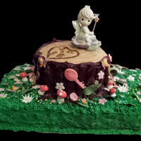 Fairy Bridal Shower Cake A Precious Moments fairy sits upon a tree stump (fun fetti cake) with carved initials of the bridal couple. Favorite flowers and keys mad...