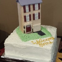 House Warming Cake  A young, newly married couple have just bought a brand new townhouse. The cake is a two layer chocolate and vanilla cake with cannoli...