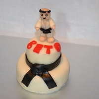 Karate Graduation Cake   Two tiered mini cake for a friend who got his black belt, wit fondant karate figurine.