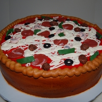 Deep Dish Pizza A Chicago style deep dish pizza with all the toppings. Toppings were made from fondant. White cake with strawberry filling with buttercream...