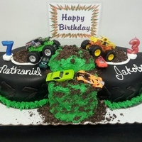 "Monster Trucks For Two Fondant covered tire cakes w/ cookie crumb ""dirt"""