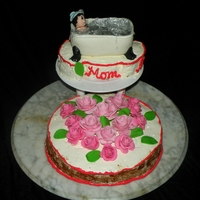 Mother's Day Cake This is a mother's day cake with roses made of MMF, the cake itself is a tiramisu cake. The bathtub and character is made of MMF as...