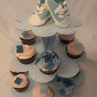 Babcy Shower Cupcake Tower baby shoes and flowers made of MMF. Simple but elegant.