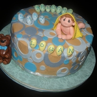 Welcoming Baby Home Mocha chiffon Cake with Marsh mallow fondant circles and gumpaste baby boy and teddy bear