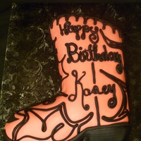 Pink Cowgirl Boot Cake trimmed to the shape of a cowboy boot and then decorated for a 16 year old girl's birthday party.