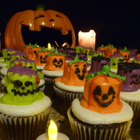Frankenstien, Jack O' Lantern, And Dracula On The March! Halloween cupcakes on the loose with Candy Covered Marshmallows.
