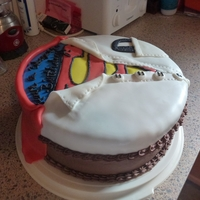 """super"" Chocolate Cake I saw a few examples of cakes similar to this here on CC and thought it would be a fun cake for a friends daughter who loves Superman. Cake..."
